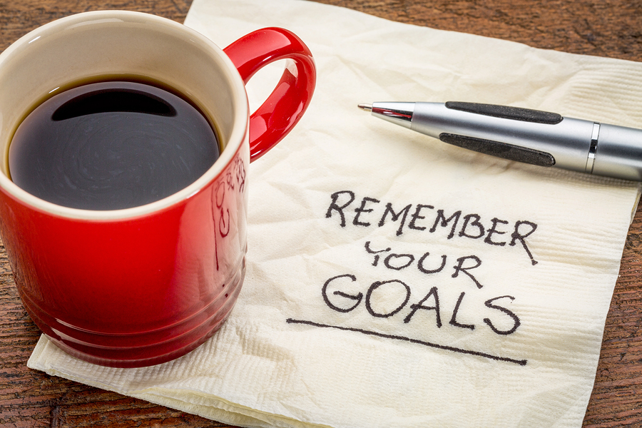 remember your goals - handwriting on a napkin with a cup of epsr